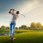 man playing on golf course