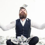 man with money raining down on him