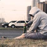 drunk man sitting on curb