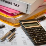 tax documents books and calculator