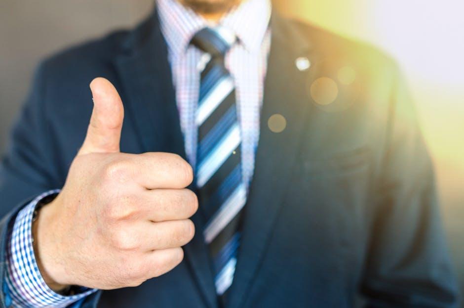 Career-Succesful Man Doing The Thumbs-up Sign