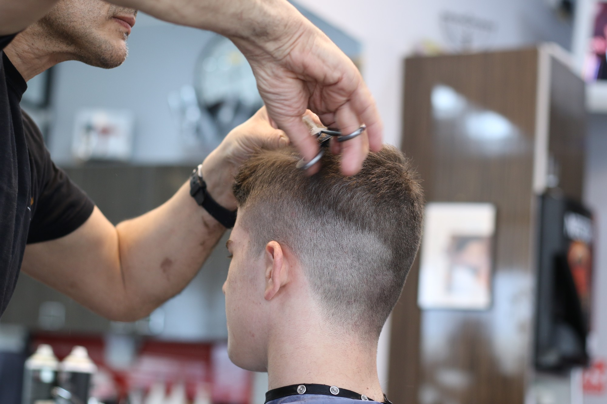 Person Getting a Masculine Haircut
