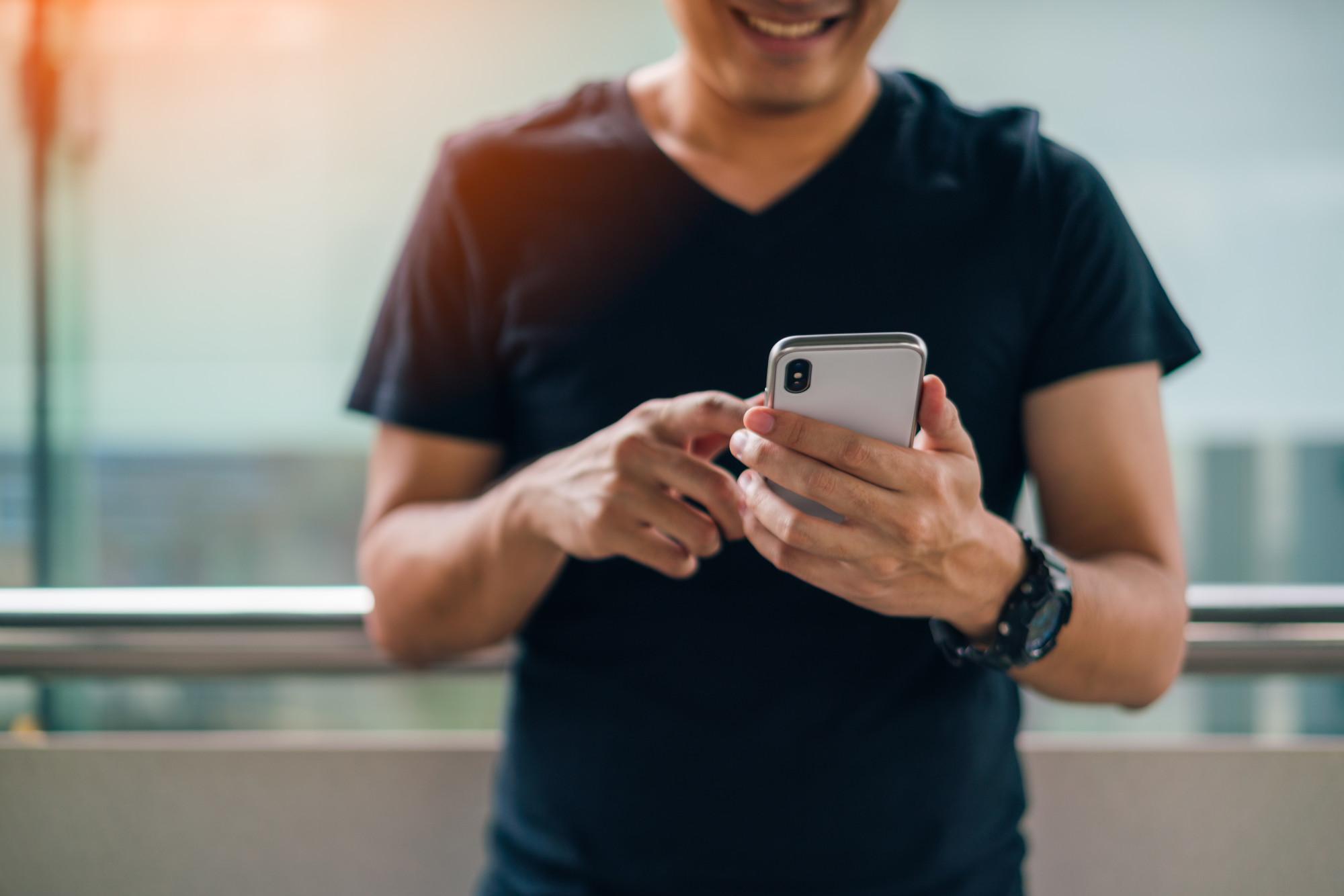 Man using an iPhone