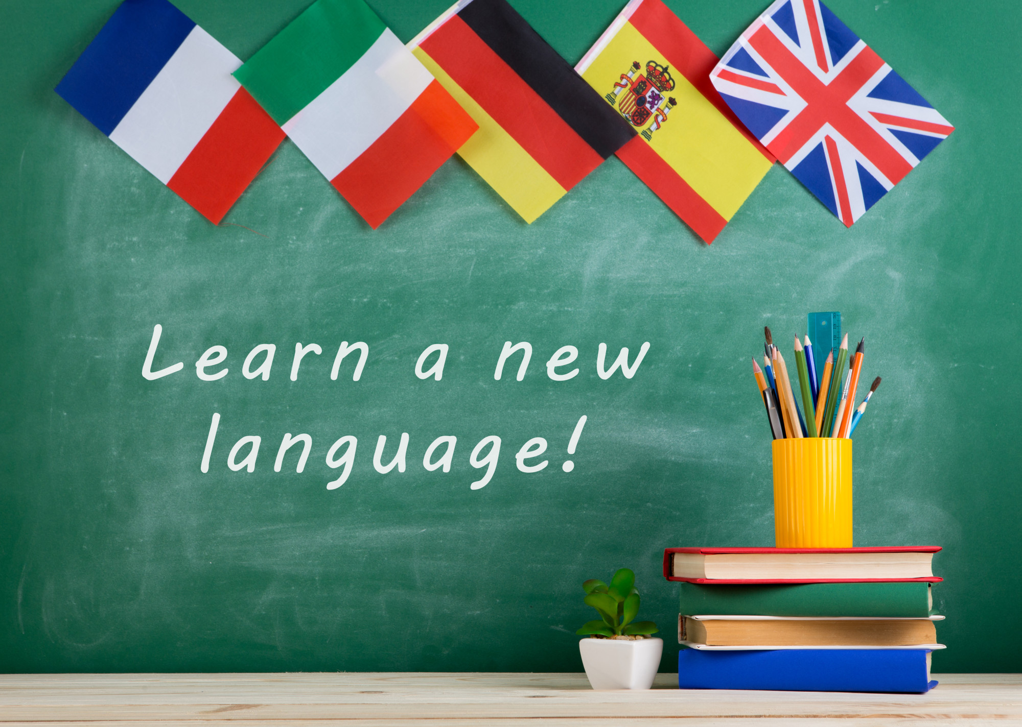 Learning a New Language Visualized by Flags, Books, and School Supplies