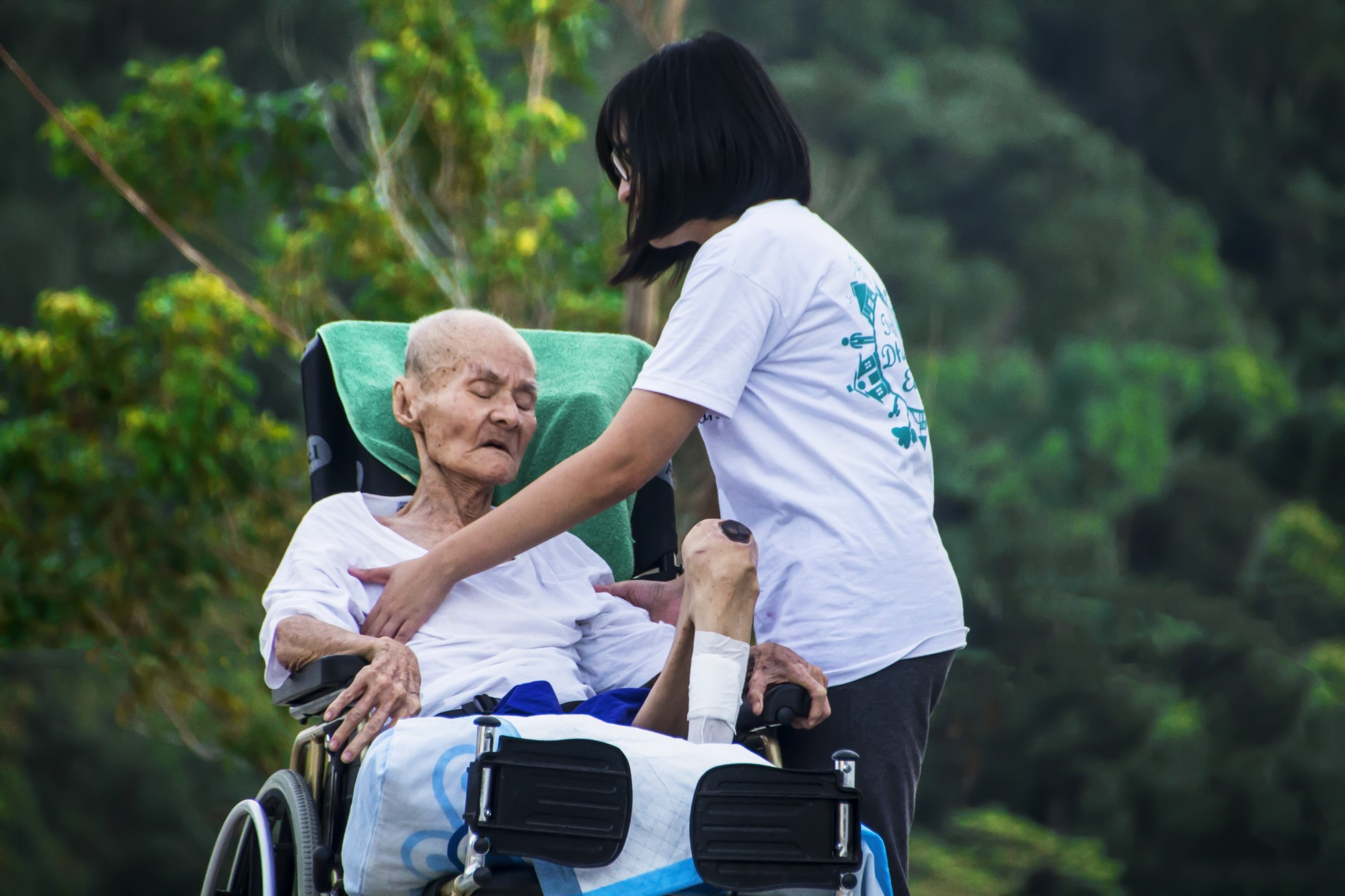 Young Woman Caregiver Taking Care of an Elderly Patient