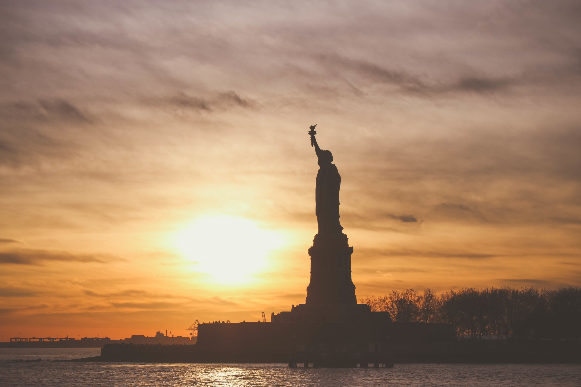 Statue of Liberty with a Sunset Background
