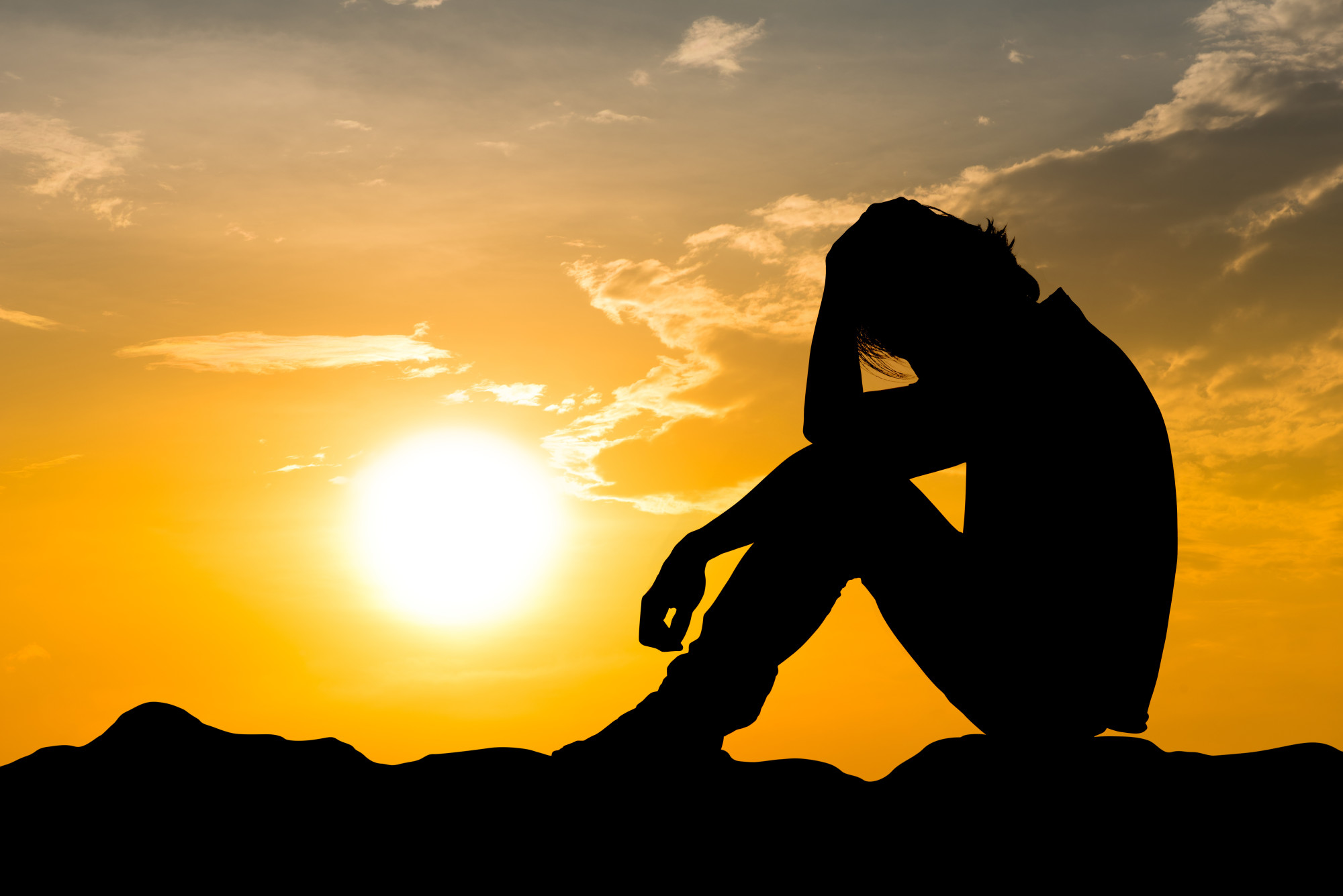 Man Suffering Addiction with a Sunset Backgrond
