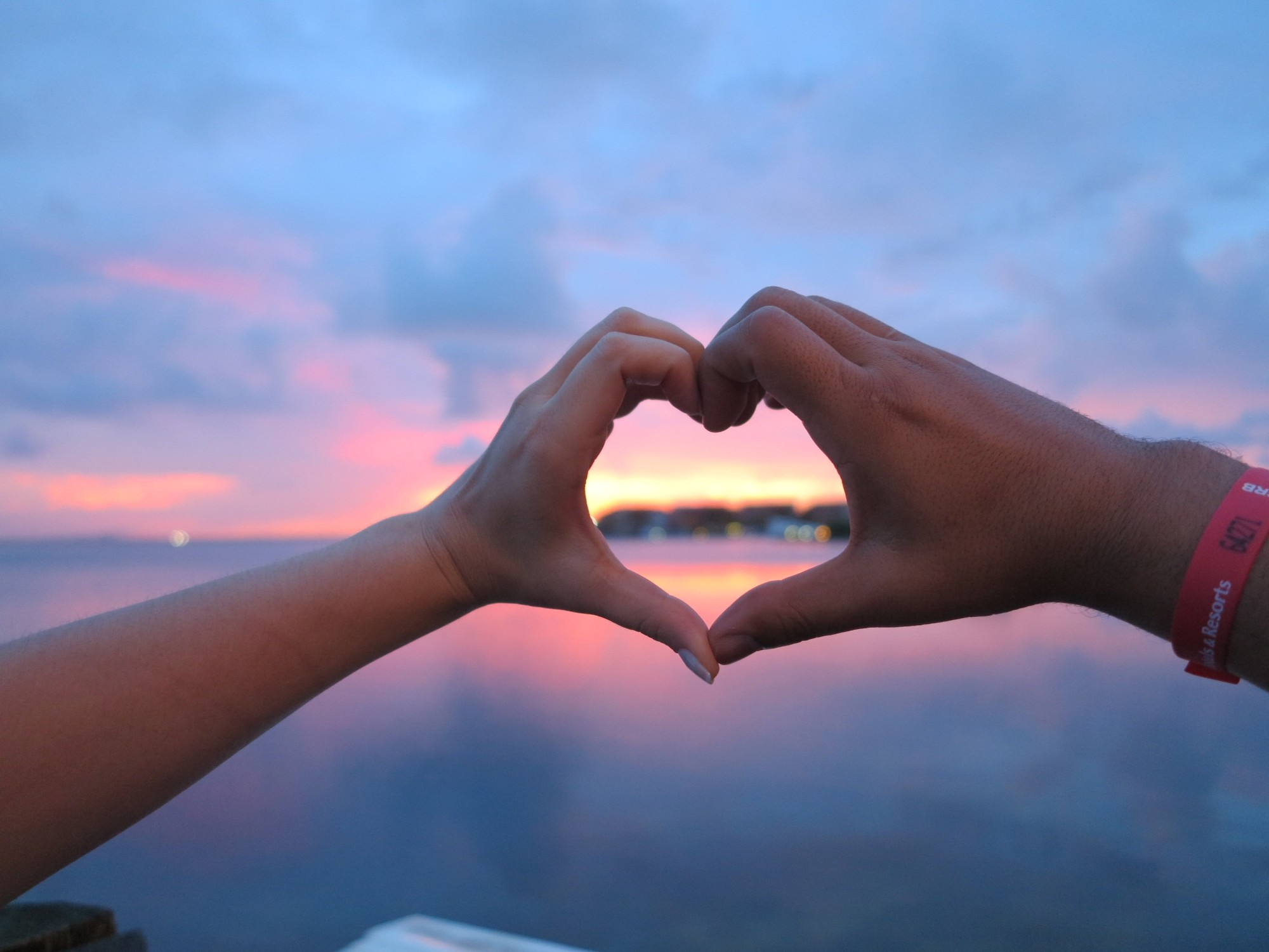 Couple Doing the Heart Gesture Using Their Hands